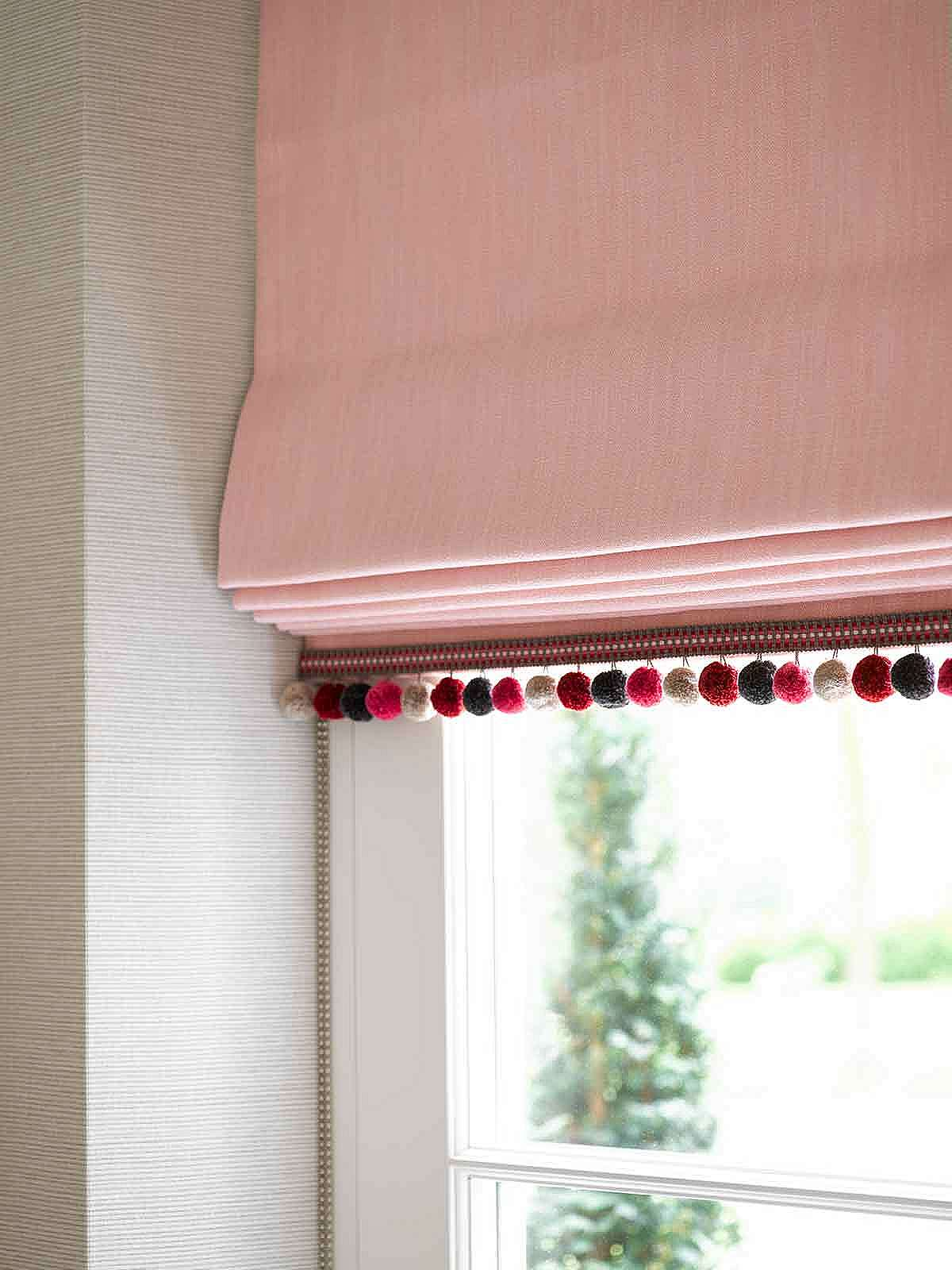 Interlined Roman blind with bobble trim to the hem