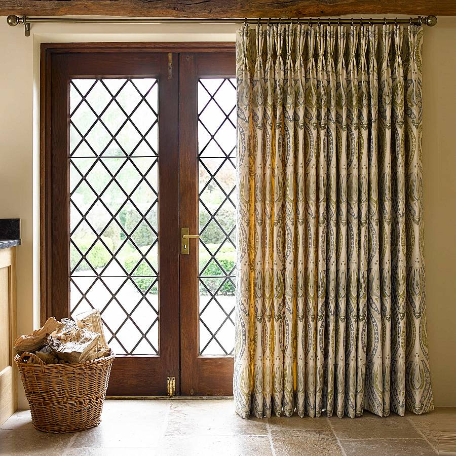 Photo of full length curtains in front of door